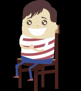 Nico emocionado sentado en una silla