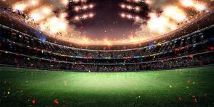 Espectadores en estadio de fútbol celebrando